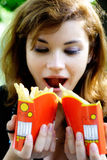 Girl With French Fries Royalty Free Stock Image