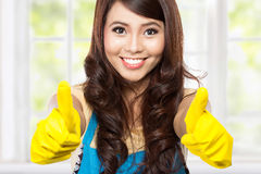Free Girl With Gloves Showing Two Tumb Royalty Free Stock Image - 47548486