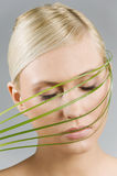 Girl With Grass Over Face Royalty Free Stock Photography