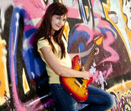 Girl With Guitar And Graffiti Wall Royalty Free Stock Images