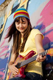 Girl With Guitar And Graffiti Wall Stock Image