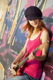 Girl With Guitar And Graffiti Wall Stock Images