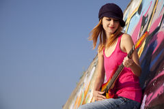 Girl With Guitar And Graffiti Wall Royalty Free Stock Photos