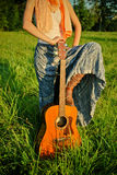 Girl With Guitar Outdoors Royalty Free Stock Photography
