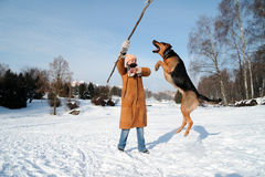Free Girl With  Jumping Dog Against Blue Sky Royalty Free Stock Images - 13035199
