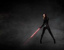 Girl With Laser Sword On Hand Stock Images