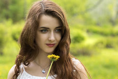 Free Girl With Long Hair And Yellow Dandelion Royalty Free Stock Photography - 93945197