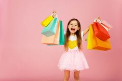 Free Girl With Many Shopping Bags On Pastel Pink Backgound. Lovely Sweet Moments Of Little Princess, Pretty Friendly Child Having Fun Royalty Free Stock Photos - 177829428