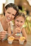 Girl With Mother Eating Royalty Free Stock Image