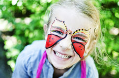 Girl With Painted Face Butterfly Royalty Free Stock Photos