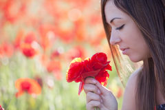 Girl With Poppies Bunch Royalty Free Stock Image