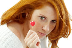 Girl With Red Hair Holding A Heart Stock Photo