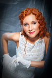 Girl With Red Hair Wearing White Dress And Gloves Stock Image