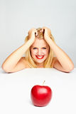 Girl With Red Lips And A Red Apple Stock Images
