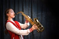 Free Girl With Saxophone Royalty Free Stock Photography - 28469477
