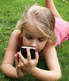 Girl With Smartphone Royalty Free Stock Photography