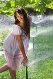 Girl With Sprinklers Royalty Free Stock Image