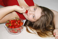 Girl With Strawberry Royalty Free Stock Images