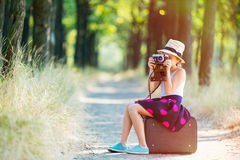 Free Girl With Suitcase And Camera Stock Photo - 75468950