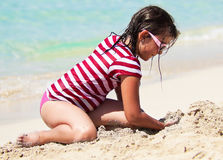 Girl With Sunglasses Playing In The Sand On A Trop Stock Images