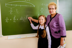 Girl With Teacher Royalty Free Stock Images