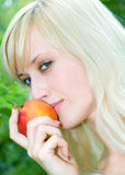 Girl With The Peach Stock Images