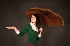 Girl With Umbrella Checking For Rain Stock Image