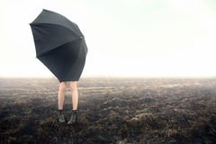 Girl With Umbrella On Black Field Royalty Free Stock Images