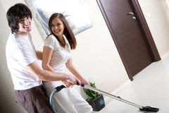 Girl With Vacuum Cleaner And Boy With Smile Stock Photography