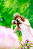 Girl With Vintage Camera Making Images Royalty Free Stock Photography
