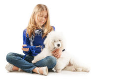 Girl With White Dog Stock Photography