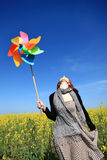 Girl With Wind Turbine At Field. Royalty Free Stock Photos
