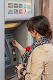 Girl withdrawing money from ATM Royalty Free Stock Photos