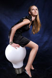 Girl witn the beeg lamp. Girl with the big lamp. Studio photo royalty free stock images