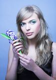 Girl witn hyacinth Stock Photography