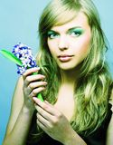 Girl witn hyacinth Stock Image