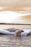 The girl woke up in a bed on water Royalty Free Stock Photo