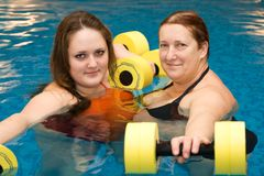 Girl and woman in aqua aerobics Royalty Free Stock Photo