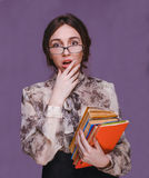 Girl woman brunette teacher in glasses with books surprised open Royalty Free Stock Images