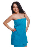 Girl woman curly brunette in blue towel after bath and shower wo Royalty Free Stock Photo