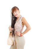 Girl or woman with extended braids hair in tight brown pants and Royalty Free Stock Photo