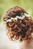 Girl woman with flower chaplet on head. Closeup portrait of girl long wavy curly hair and flowers chaplet on head. Attractive young woman model in park outside Royalty Free Stock Photos