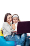 The girl with the woman in front of the computer Royalty Free Stock Images