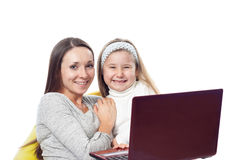The girl with the woman in front of the computer Stock Photo
