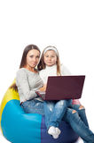 The girl with the woman in front of the computer Royalty Free Stock Photo
