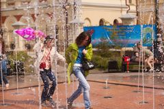 Girl with a woman near the fountain Stock Photography