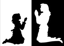 Girl and Woman in Prayer. Silhouettes of a young girl and a woman in prayer Royalty Free Stock Images