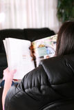 Girl or woman reading magazine Stock Image
