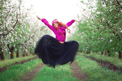 Girl woman red-haired in spring garden Stock Images