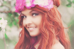 Girl woman red-haired in spring garden Stock Image